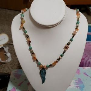 Hand made necklace with antique style wing.